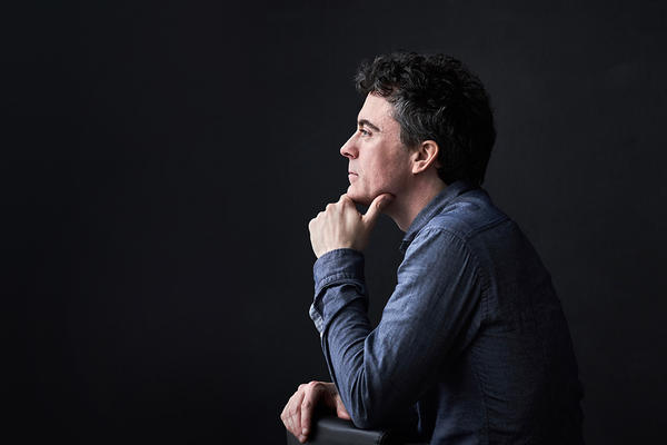Profile photo of Paul Lewis against a black background