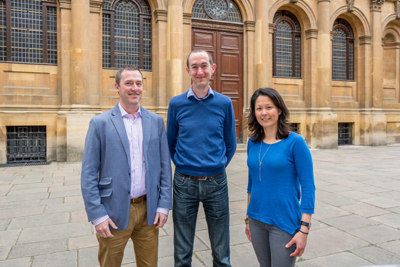 Photo of the Sheldonian Curators, Prof Stephen Payne, Dr Andrew Fairweather-Tall and Ms Genevieve J Garrido, standing outside the Sheldonian