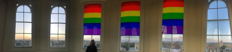 Photo of inside of Sheldonian Theatre cupola with rainbow colours on windows
